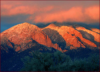 "The iconic Taos Mountains in the sunset are truly ""purple mountains majesty"" in Northern New Mexico. New Mexico"