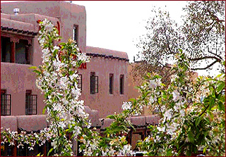 The historic Taos Plaza in spring. The Taos Plaza offers the visitor to New Mexico culture, history and art galleries. You can also enjoy great shopping and dining on the Plaza, the Bent Street historic district and more.